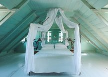 Dreamy-attic-bedroom-with-pastel-green-walls-and-floor-in-matching-hue-creates-a-monochromatic-backdrop-77860-217x155