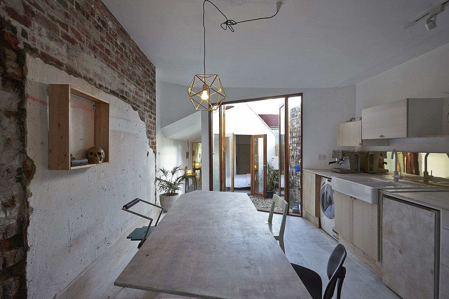 Exposed-brick-walls-rugged-plaster-finish-and-eclectic-mix-of-decr-give-this-room-a-unique-style-65749