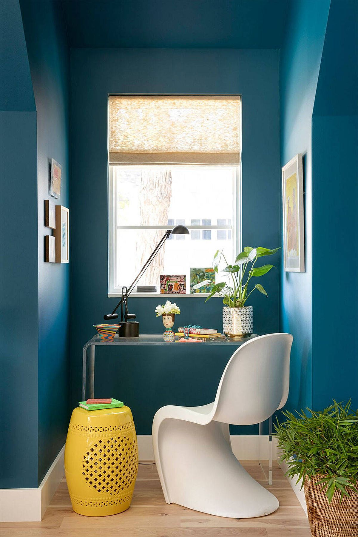 Exquisite blue home office with modern eclectic style and just a dash of yellow