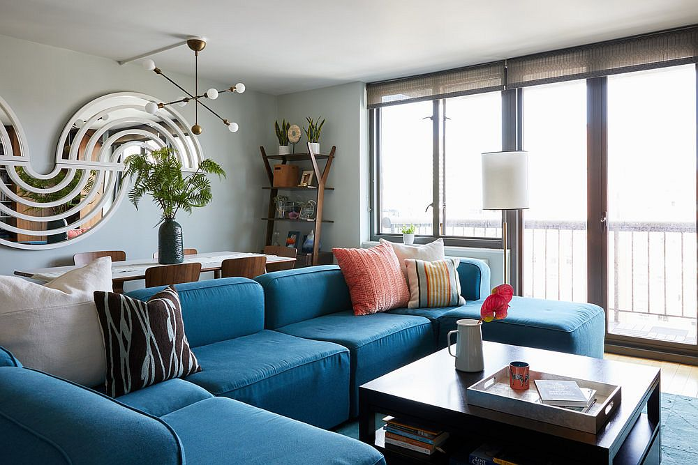 Fabulous and luxurious sofa in blue offers ample sitting space for everyone in the room