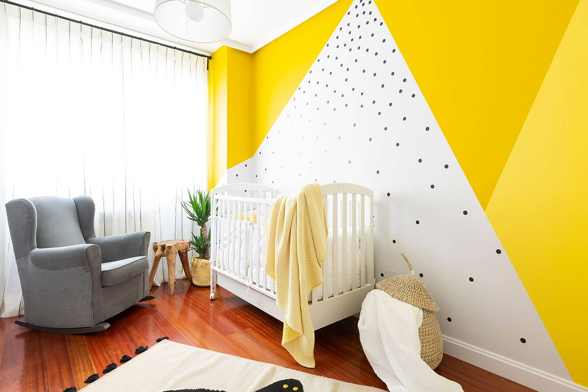 Fabulous gender-neutral beach style nursery with accent yellow wall that steals the show