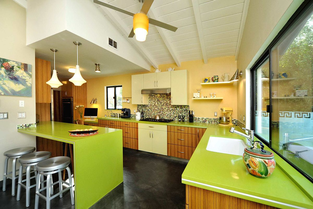 Fabulous-mid-century-modern-kitchen-with-yellow-accent-wall-and-eye-catching-green-countertops-24657