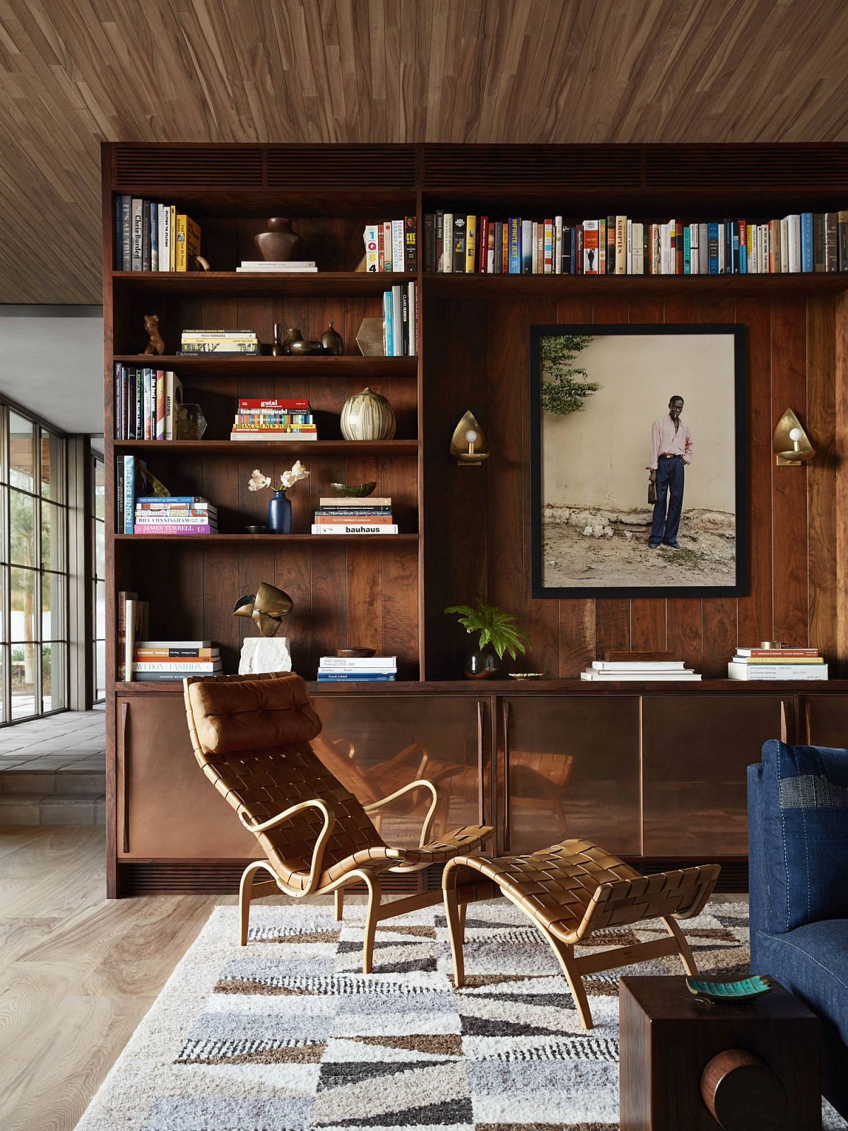 Fabulous walnut shelves and cabinets used throughout the house give it a cozy, modern look