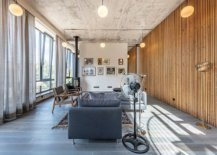 Fabulous-wooden-wall-in-the-living-area-and-entry-brings-warmth-to-the-space-with-concrete-and-metallic-finishes-57753-217x155