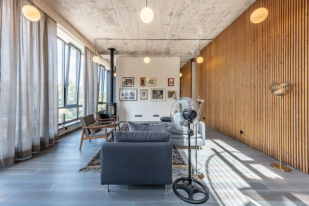 Fabulous wooden wall in the living area and entry brings warmth to the space with concrete and metallic finishes