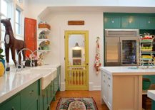Farmhouse-style-kitchen-with-greeen-cabinets-and-a-door-in-yellow-along-with-vintage-wooden-shutter-in-the-corner-26389-217x155