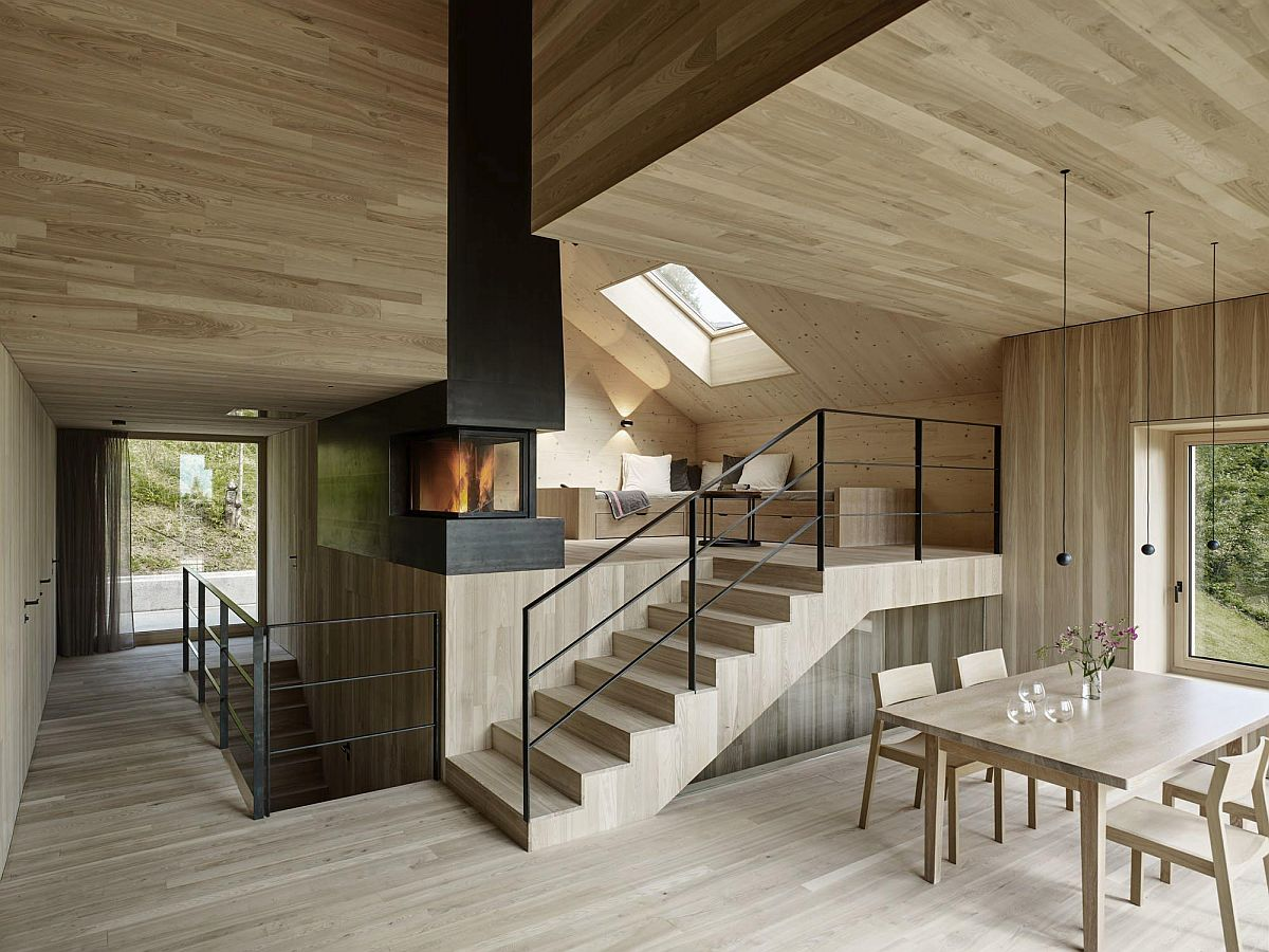 Fireplace at the heart of the multi-level living area provides warmth to different sections