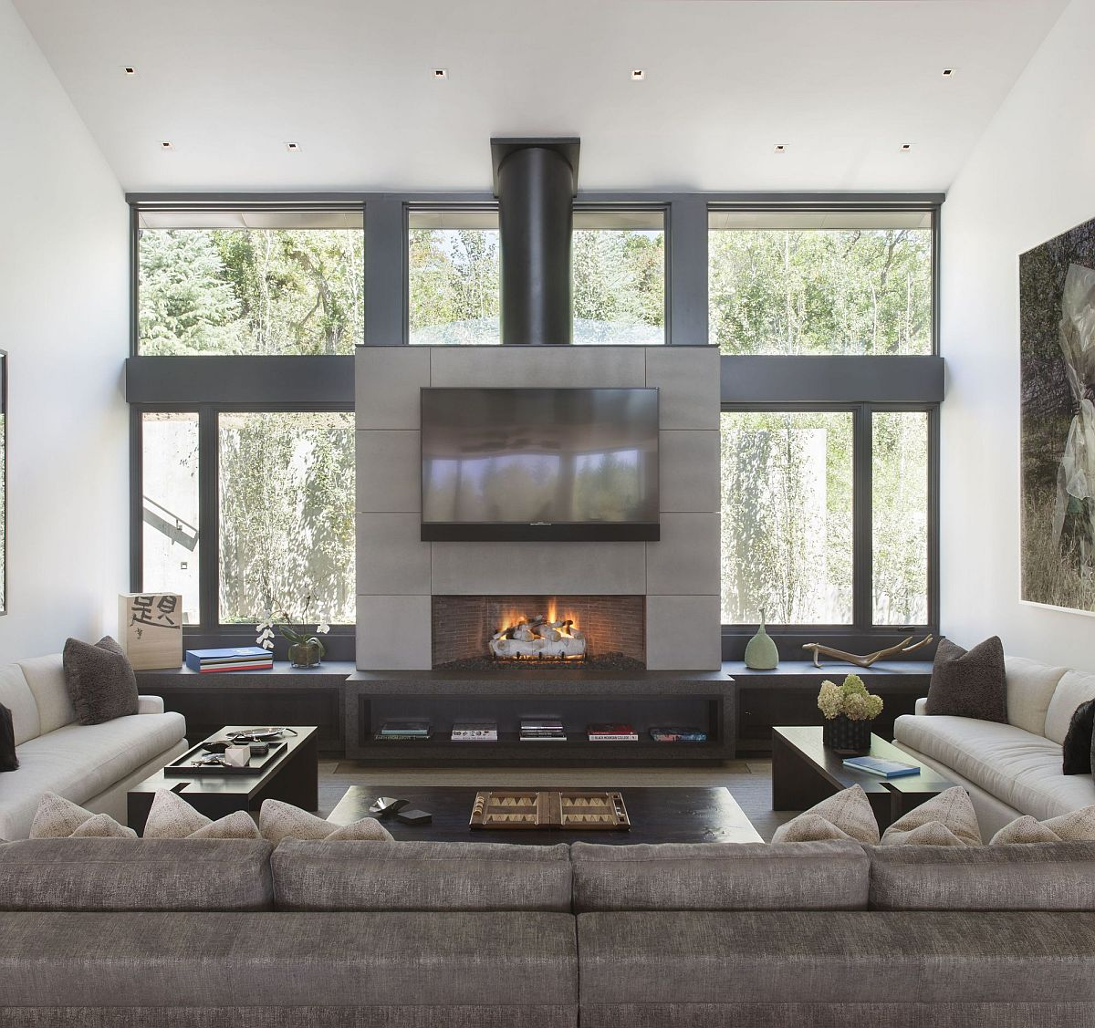 Fireplace sits at the heart of the contemporary living room with comfortable couches all around
