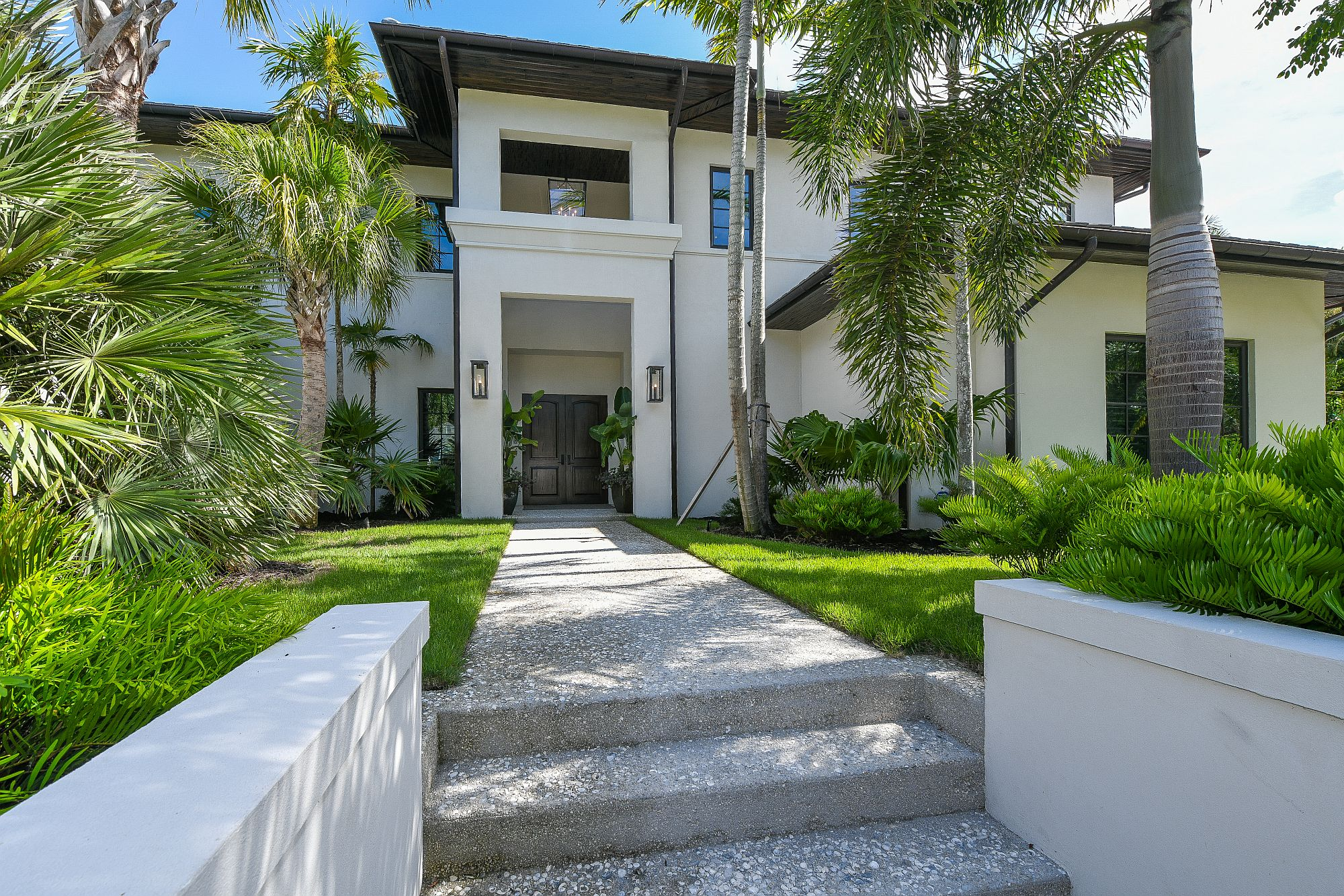 French West Indies style is combined with tropical goodness of Florida to create a luxurious modern home