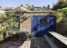 Garden-Studio-with-dashing-blue-door-and-window-frames-separates-itself-from-the-main-house-45309-217x155
