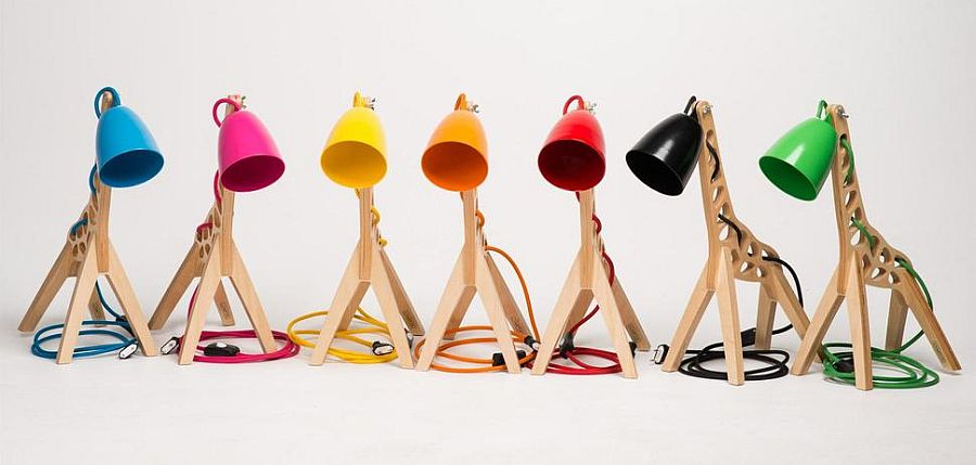 Giraffe-shaped table lamp comes with different colored lamp shades that make it more exciting