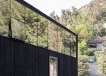 Glass-and-dark-wood-shape-the-exterior-of-the-El-Arrayan-House-in-Chile-22769-217x155