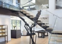 Glass-railing-for-the-wooden-staircase-gives-your-home-a-more-modern-and-airy-appeal-75967-217x155