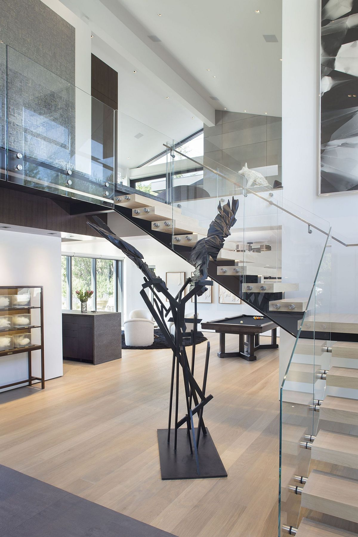 Glass railing for the wooden staircase gives your home a more modern and airy appeal