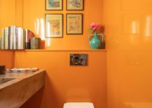 Glosy-bathroom-walls-in-orange-with-a-wooden-vanity-create-a-light-filled-and-vivaciou-setting-96935-217x155