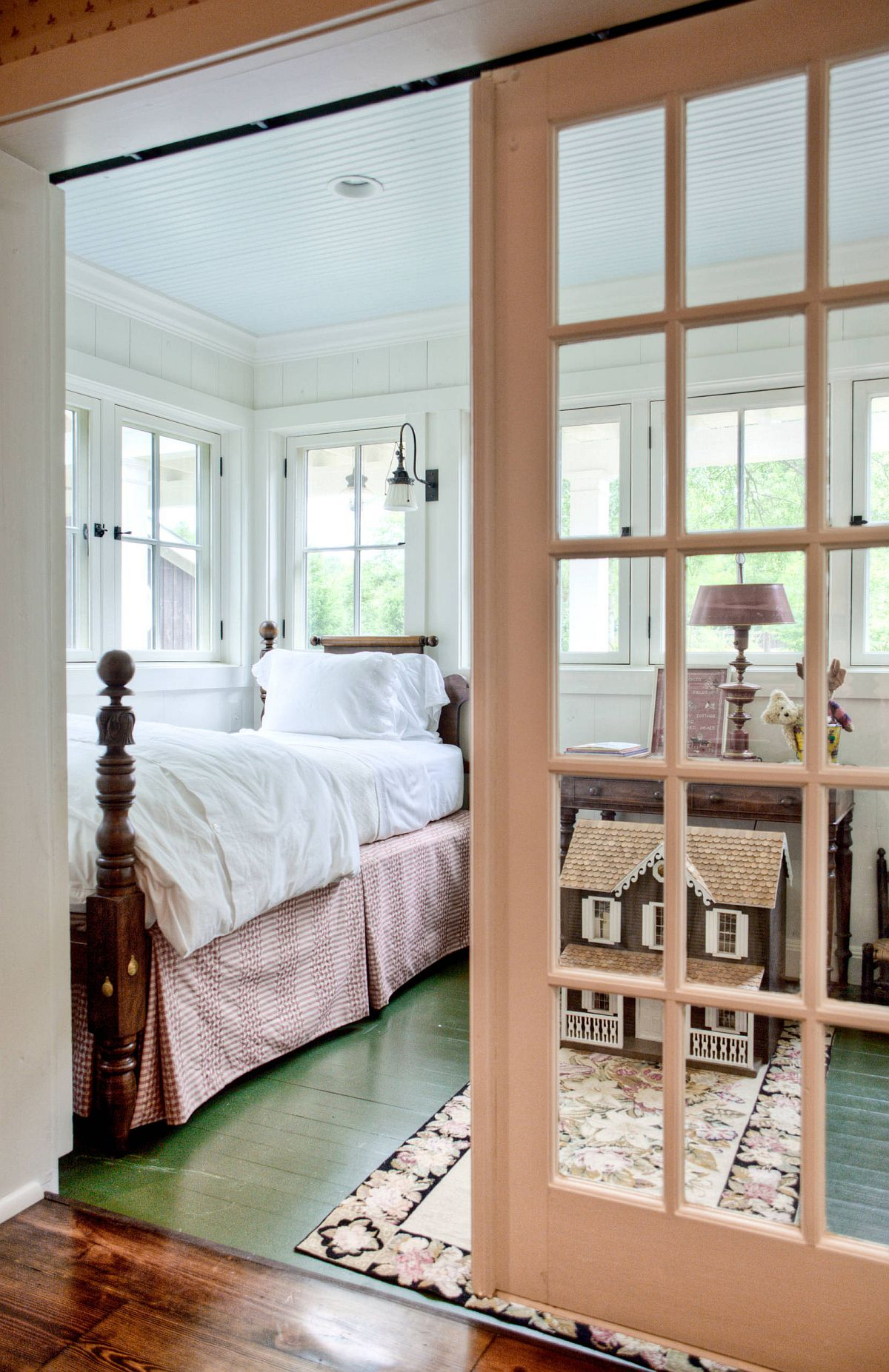 Gorgeous farmhouse bedroom with painted floor in green with white and wood all around
