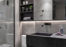Graphite-porcelain-and-carved-countertops-shape-the-stylish-kitchen-in-white-and-gray-84970-217x155