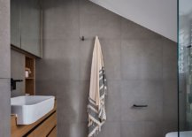 Gray-bathroom-with-floating-wooden-vanity-and-white-sink-77448-217x155