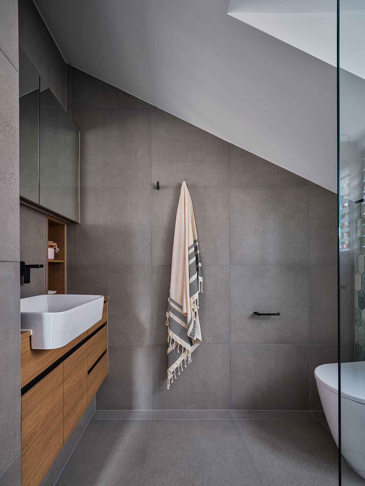 Gray-bathroom-with-floating-wooden-vanity-and-white-sink-77448