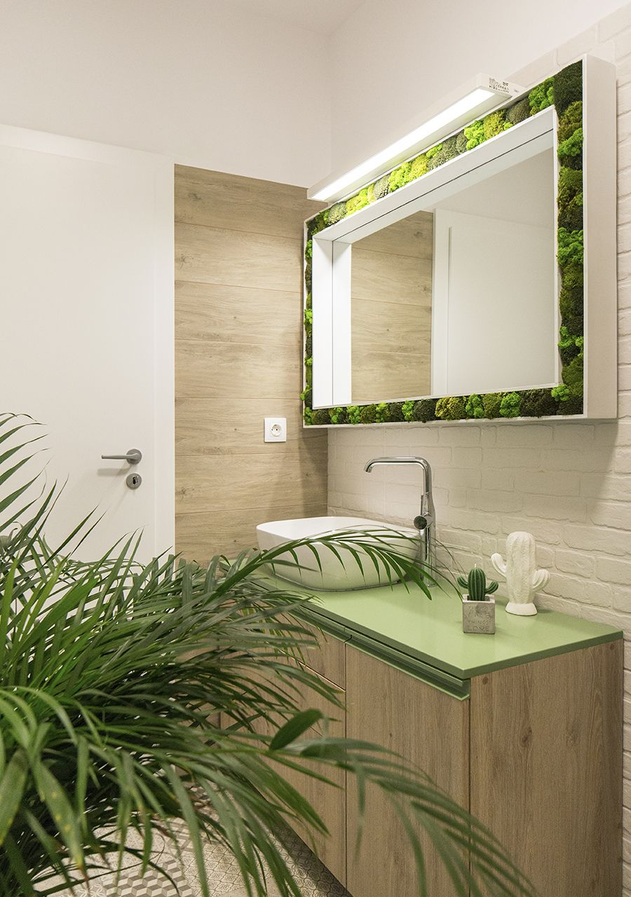 Green countertop for the small modern bathroom along with an indoor plant