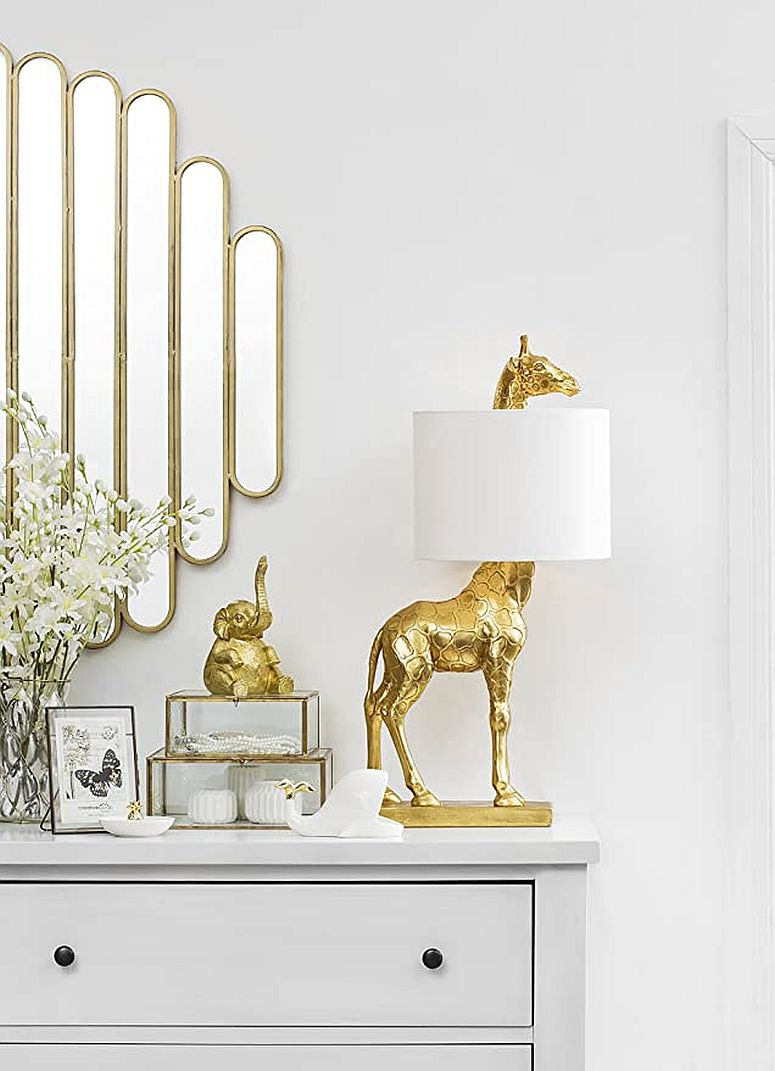 Harbaugh Table Lamps brings the shape of the giraffe with a golden finish