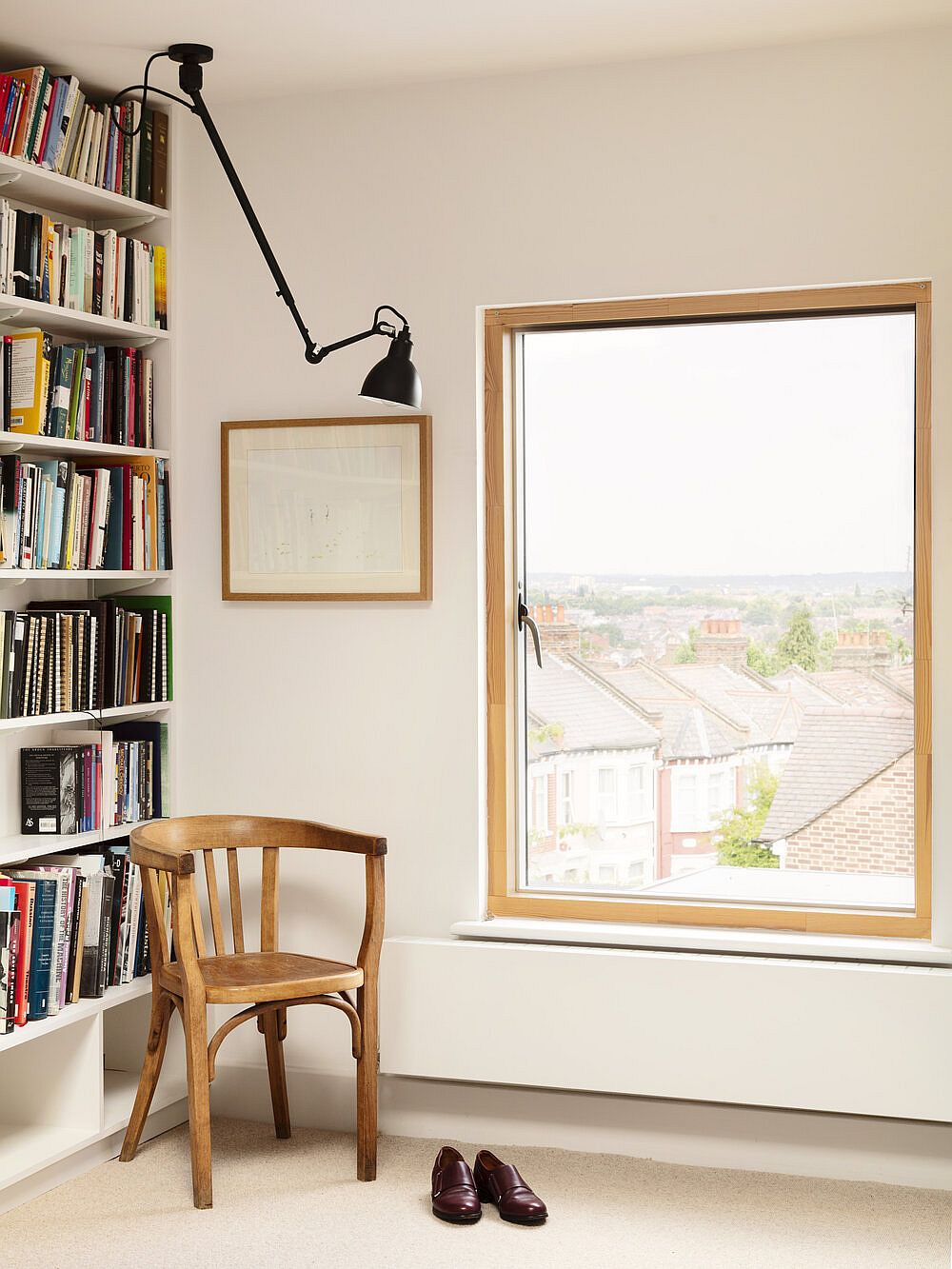 Home office and reading room on the upper level with natural light and flexible sconce light