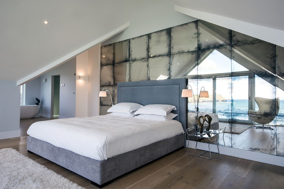 Imaginative way of adding gray accent wall to a room already filled with light bluish-gray