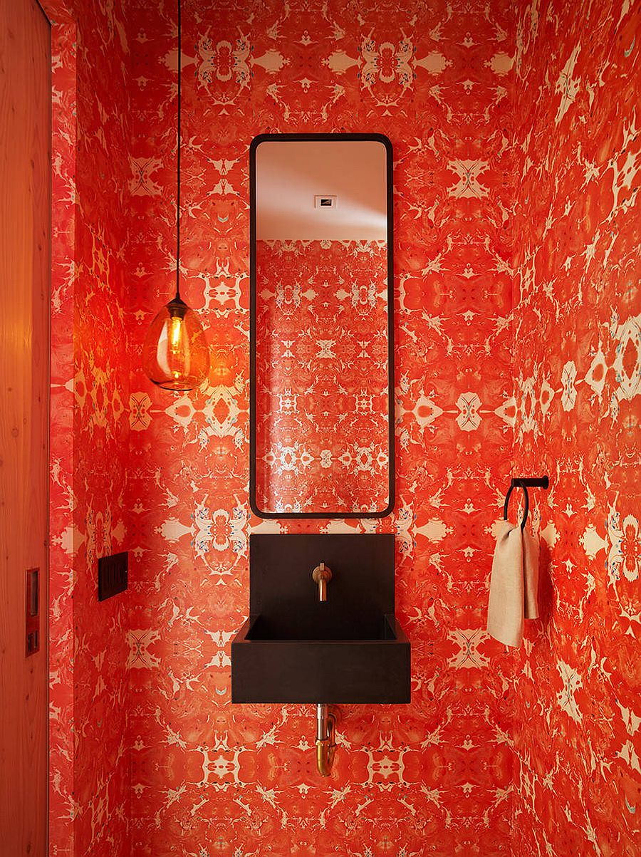 Ingenious powder room with brick red wallpaper that feels absolutely classy