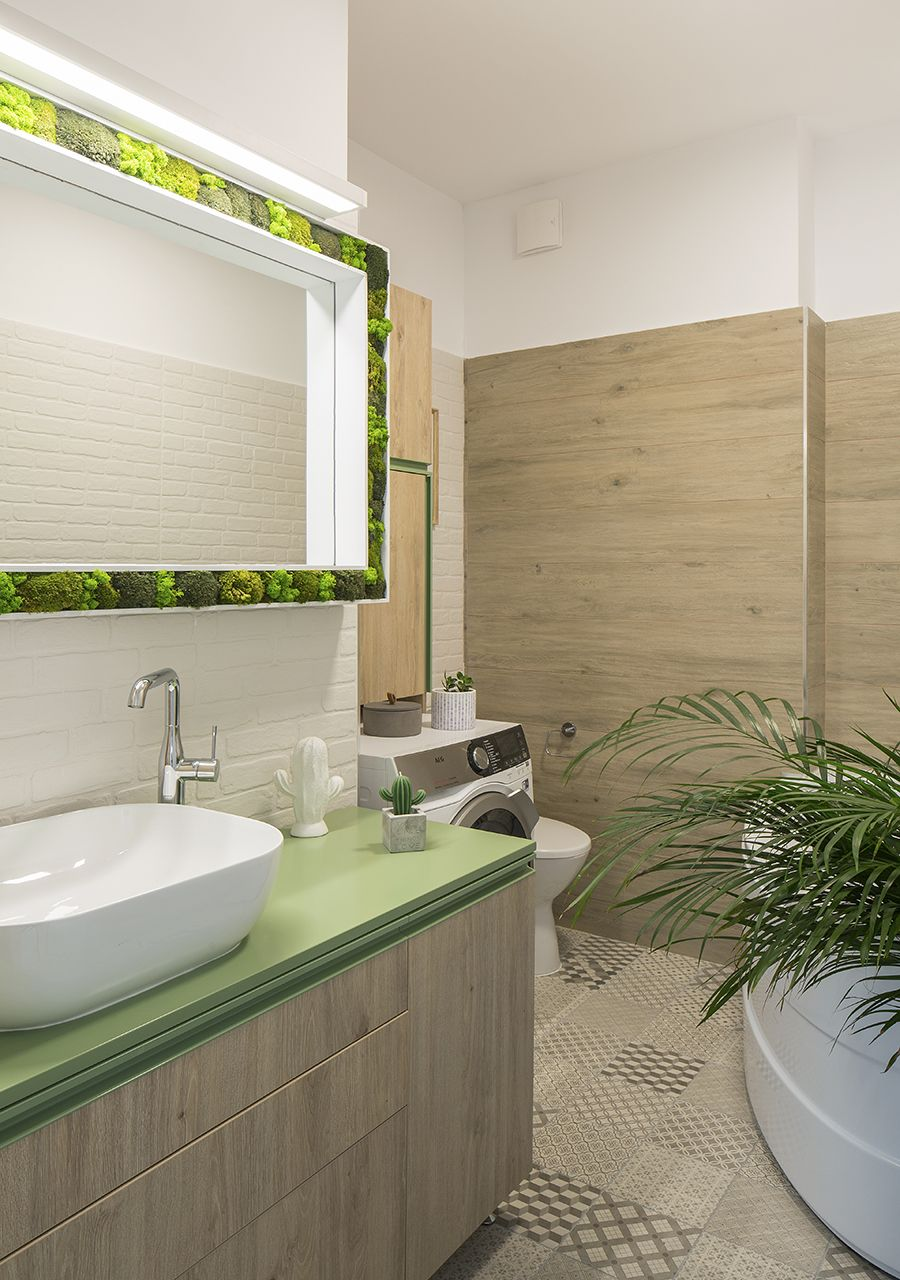 Interesting living green frame for the bathroom gives it a lively, colorful tinge