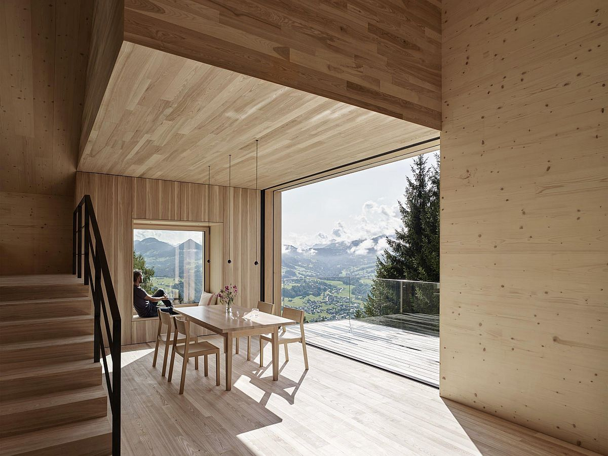 Interior clad in wood is split across multiple levels to offer amazing views of the landscape