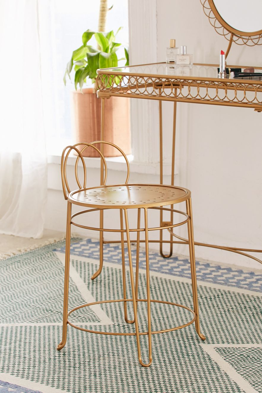 Iron vanity stool with a gold-toned finish