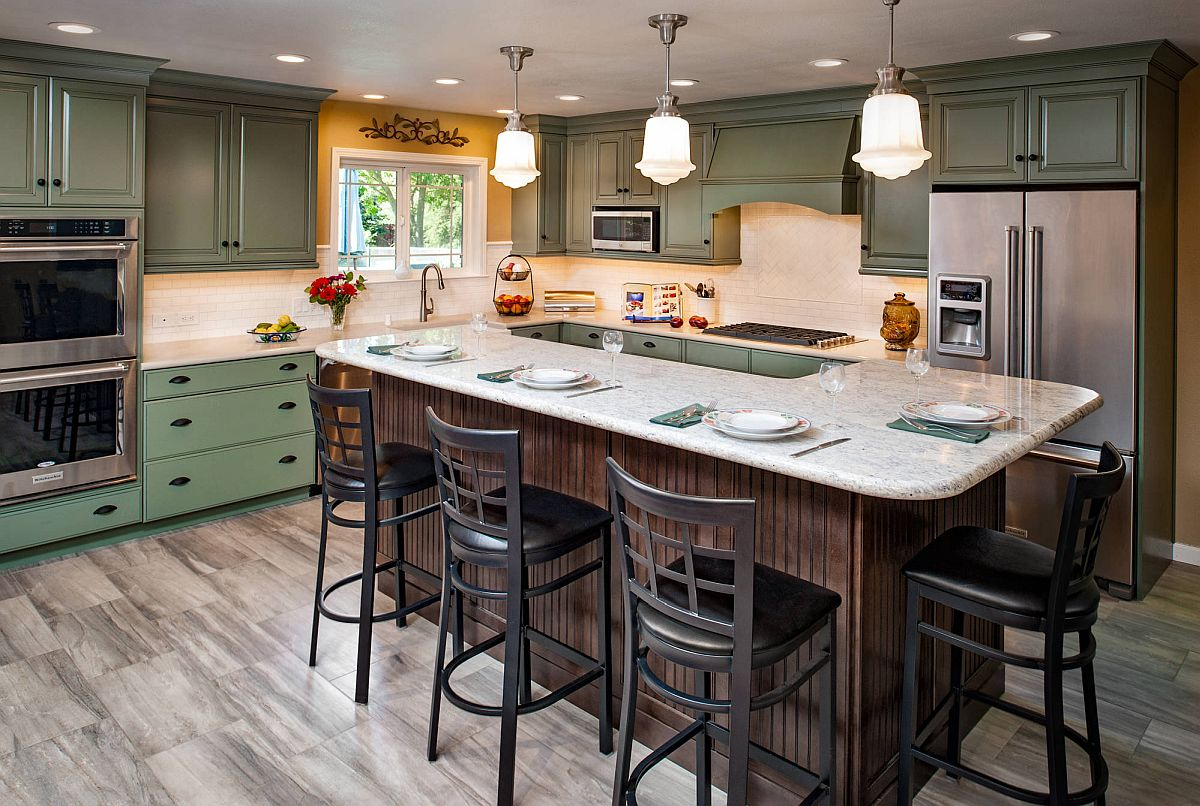 Just-a-dash-of-yellow-around-the-kitchen-window-enlivens-this-space-with-clasic-green-cabinets-53797