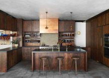 Kitchen-with-concrete-ceiling-and-floor-along-with-wram-wooden-shelves-in-Walnut-38079-217x155
