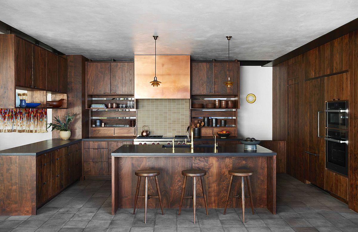 Kitchen with concrete ceiling and floor along with wram wooden shelves in Walnut