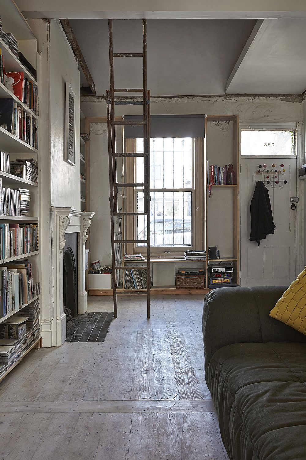 Ladder-is-sued-o-access-the-upper-shelves-in-the-hallway-58114