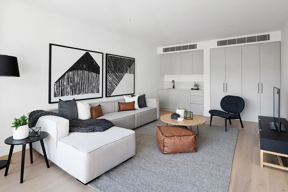 Large contemporary sectional in white sits perfectly in this beautiful and modest living room