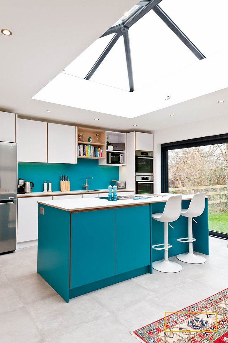 Large glass dome above brings ample natural light into the breezy kitchen in white and turquoise
