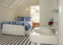 Light-blue-painted-wood-floor-along-with-striped-rug-adds-color-to-the-fabulous-beach-style-bedroom-65624-217x155
