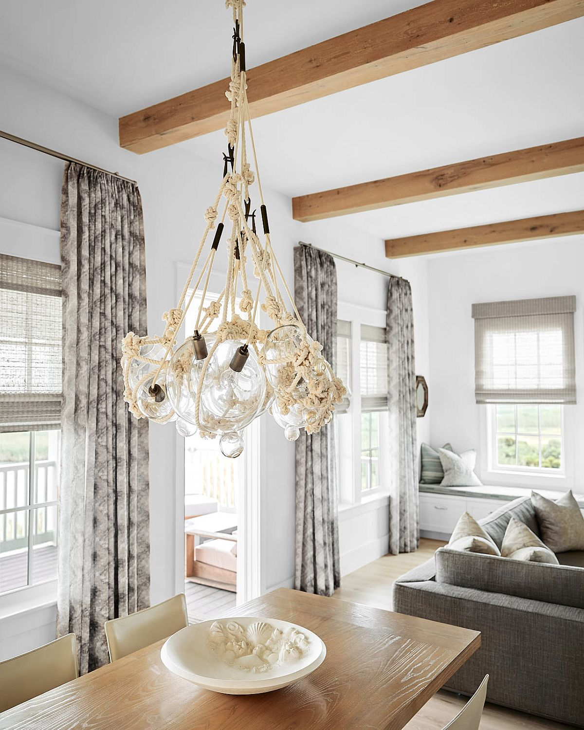 Lighting fixture in the dining room adds to the casual beach style of the home
