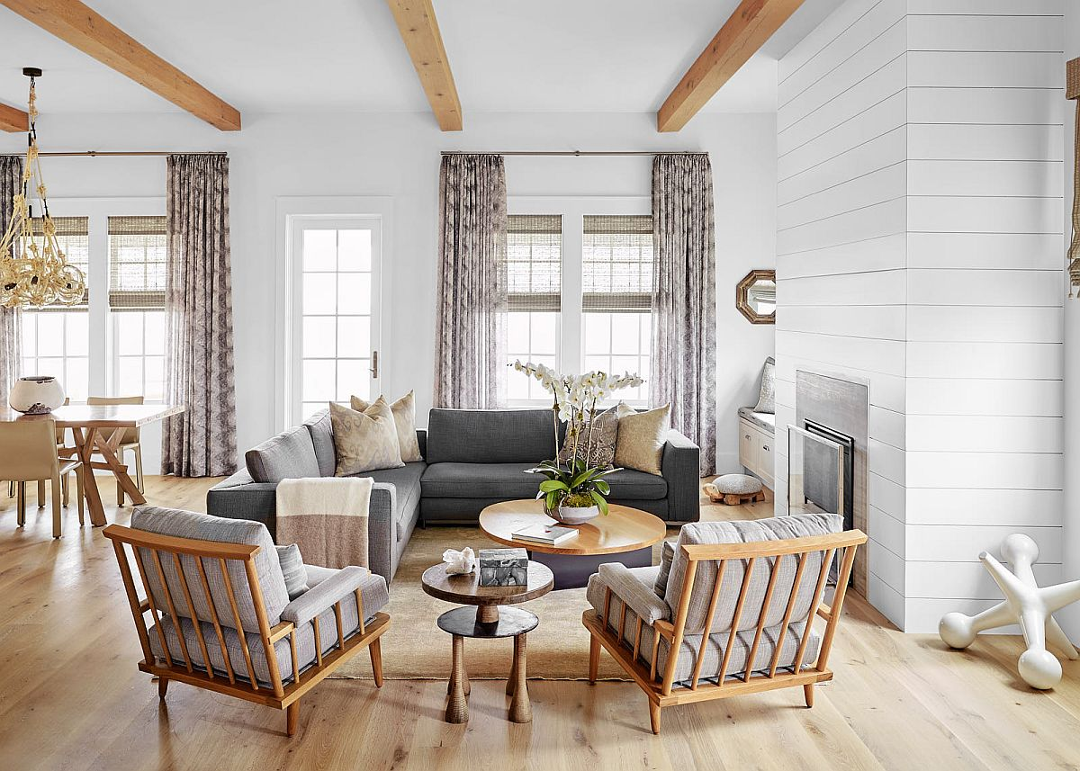Living room walls with textural charm, ceiling beams that add woodsy element and cool decor