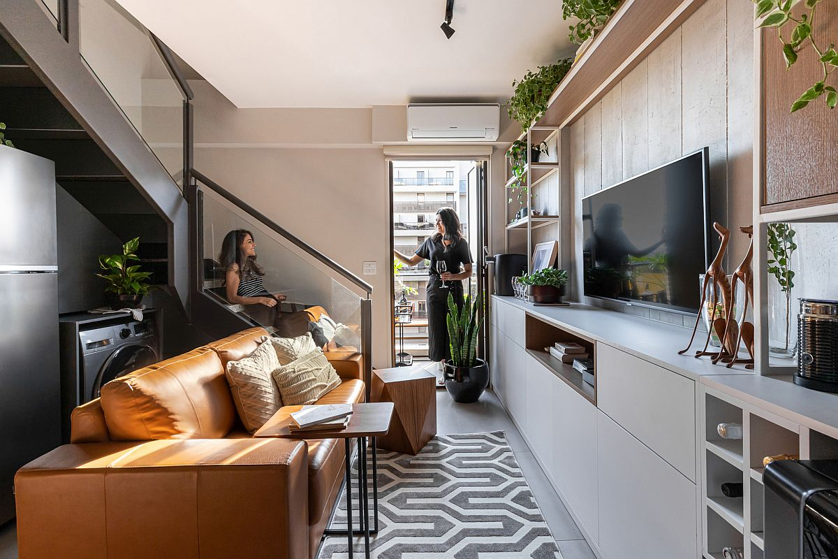 Lower level living area and social zone of the Simpatia Apartment in Brazil