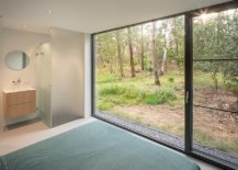 Main-bedroom-of-the-house-with-sliding-glass-doors-that-lead-into-the-woods-35109-217x155