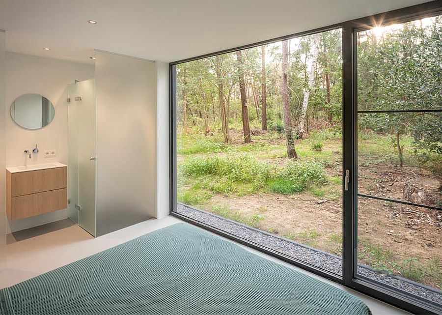 Main bedroom of the house with sliding glass doors that lead into the woods