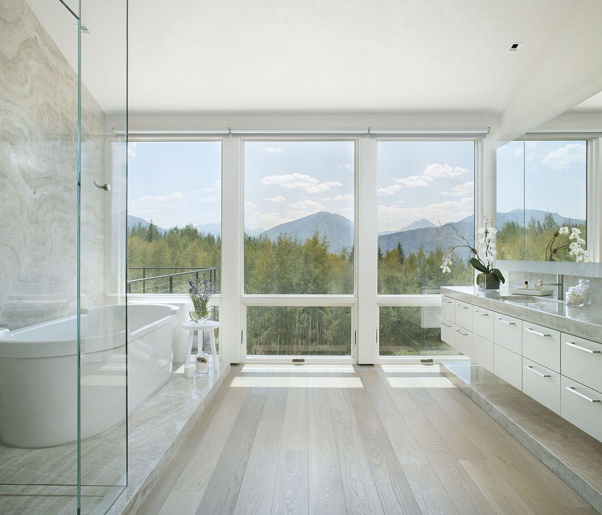 Marble and wood bathroom in white offers a lovely monochromatic backdrop