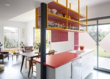 Metallic-grid-shelf-hanging-down-from-the-eciling-adds-a-storage-option-in-the-kitchen-15790-217x155