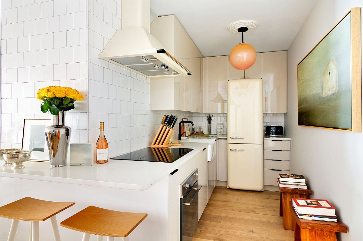 Midtown apartment kitchen in New York that maximizes space with ample shelving and a backdrop in white