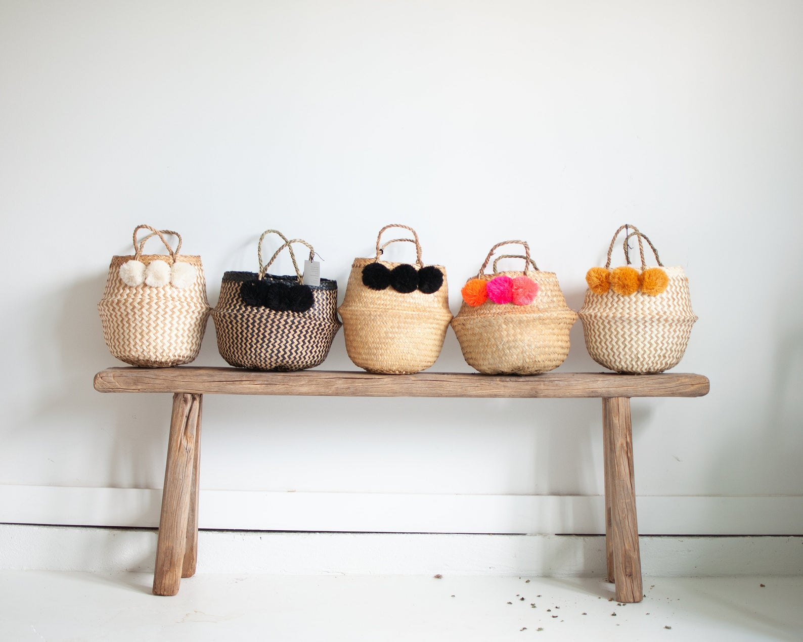 Mini woven baskets with pom poms