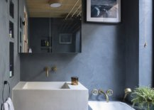 Modern-bathroom-of-the-classic-London-home-in-wood-and-gray-feels-a-lot-more-polished-than-the-main-residence-66984-217x155