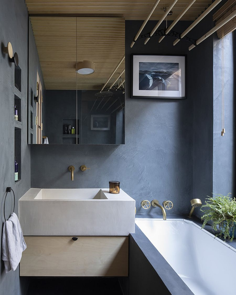 Modern bathroom of the classic London home in wood and gray feels a lot more polished than the main residence
