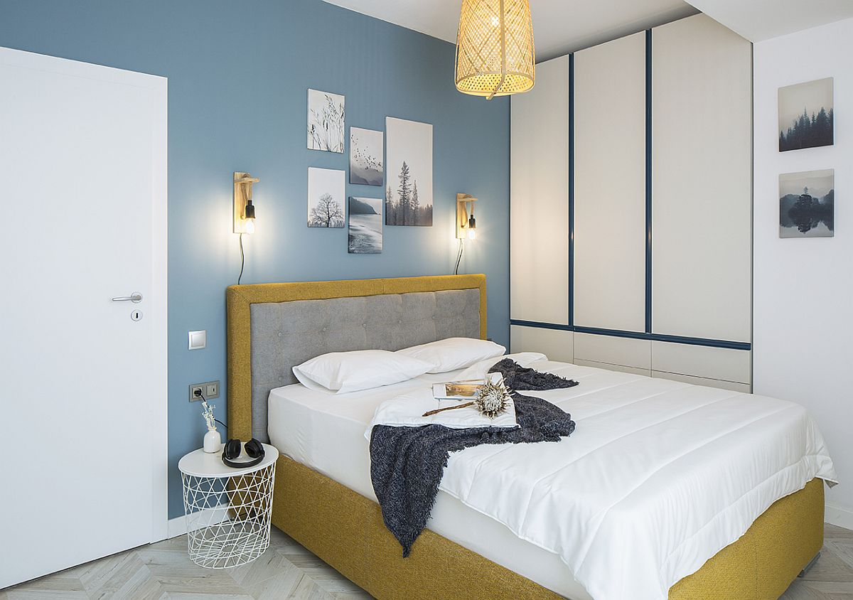 Modern bedroom in gorgeous light blue and white with a cheerful appeal